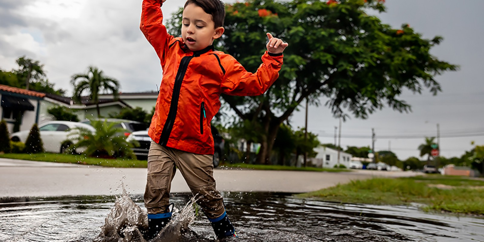 boy playing in puddle image
